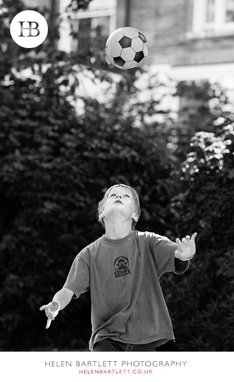 blogImagefamily-photographer-kensington-w14-water-fun-superhero-22