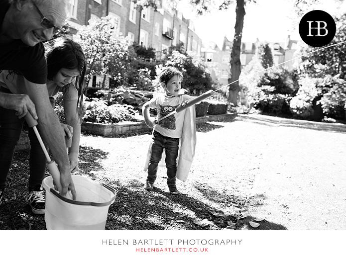 blogImagefamily-photographer-kensington-w14-water-fun-superhero-30