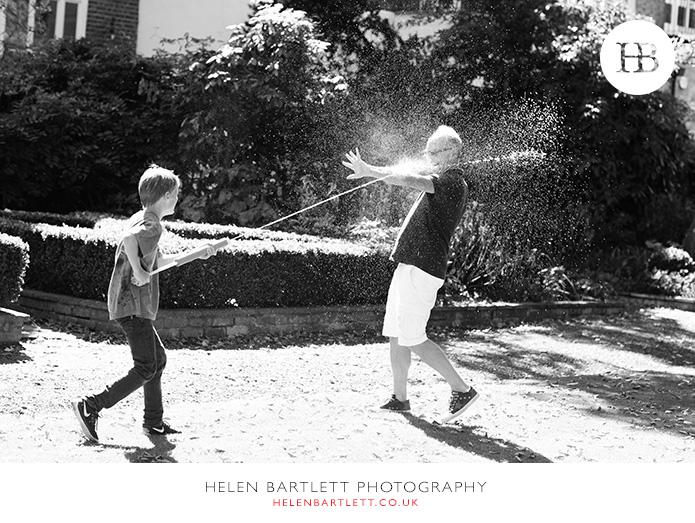 blogImagefamily-photographer-kensington-w14-water-fun-superhero-31
