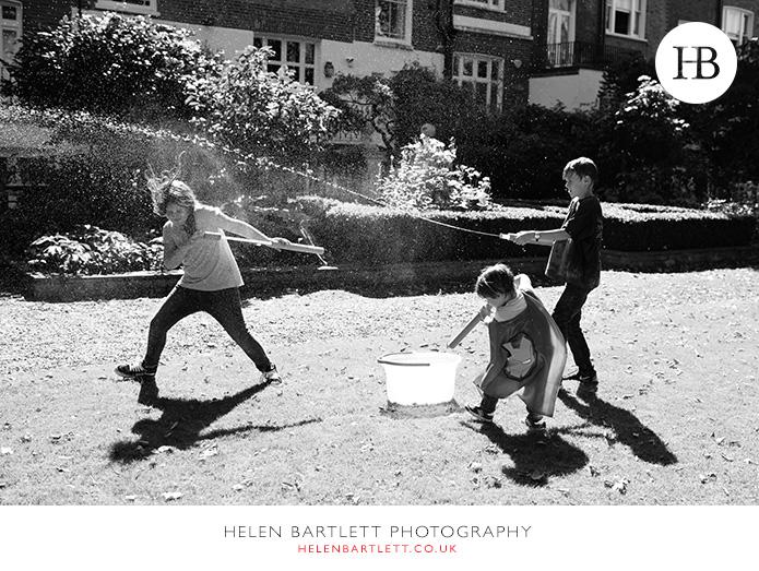 blogImagefamily-photographer-kensington-w14-water-fun-superhero-32