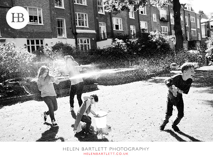 blogImagefamily-photographer-kensington-w14-water-fun-superhero-33
