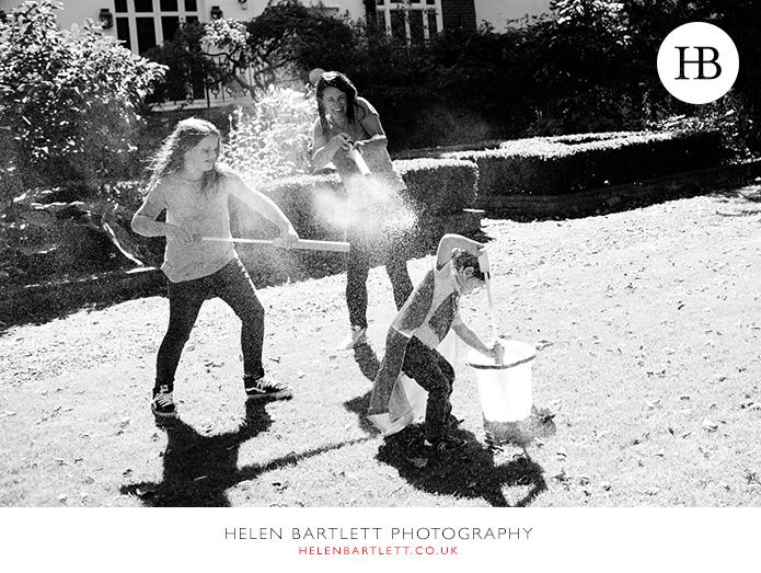 blogImagefamily-photographer-kensington-w14-water-fun-superhero-34