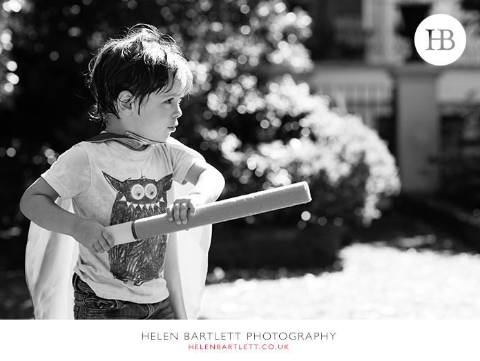 blogImagefamily-photographer-kensington-w14-water-fun-superhero-35