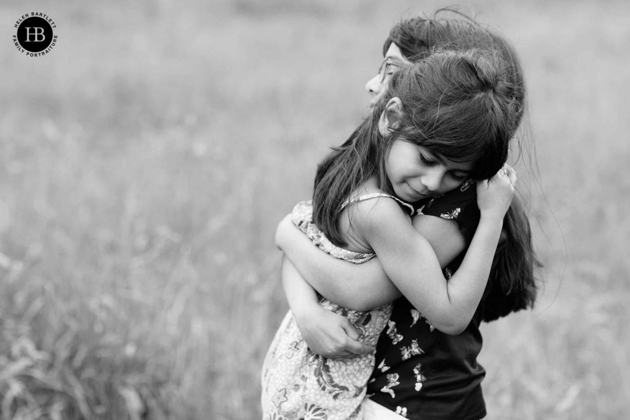 sisters hug on family photography shoot in Islington N1