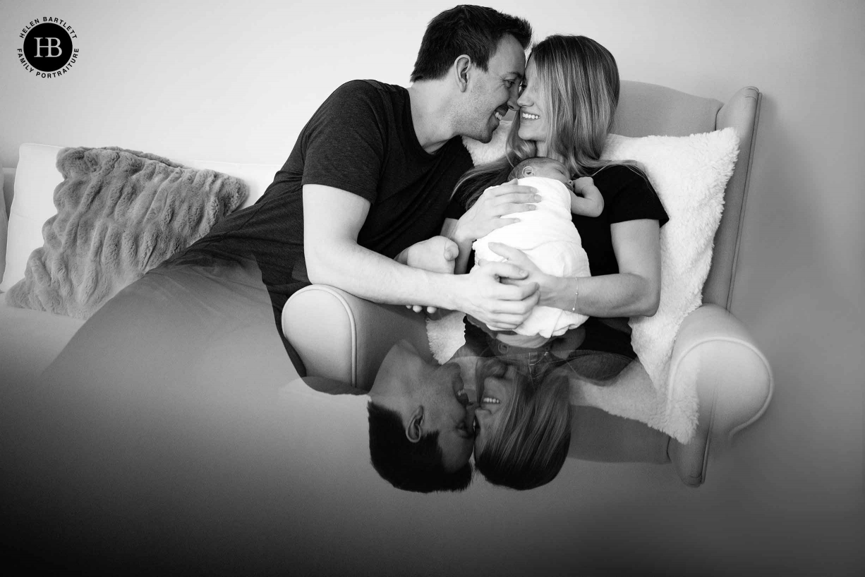 professional newborn family photo with prism reflection