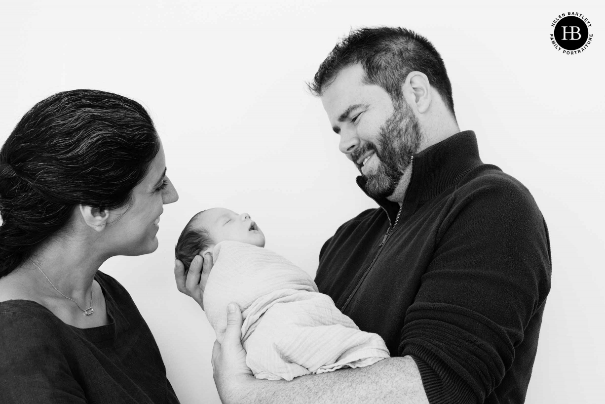 parents smile at sleeping baby son