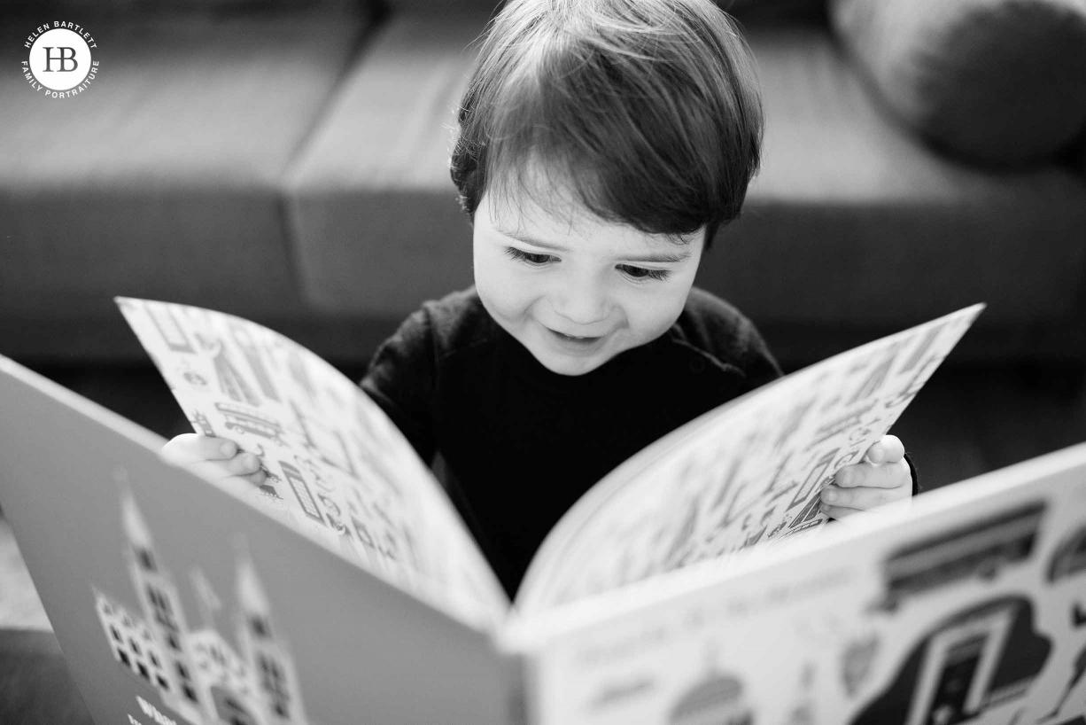 toddler reads big book