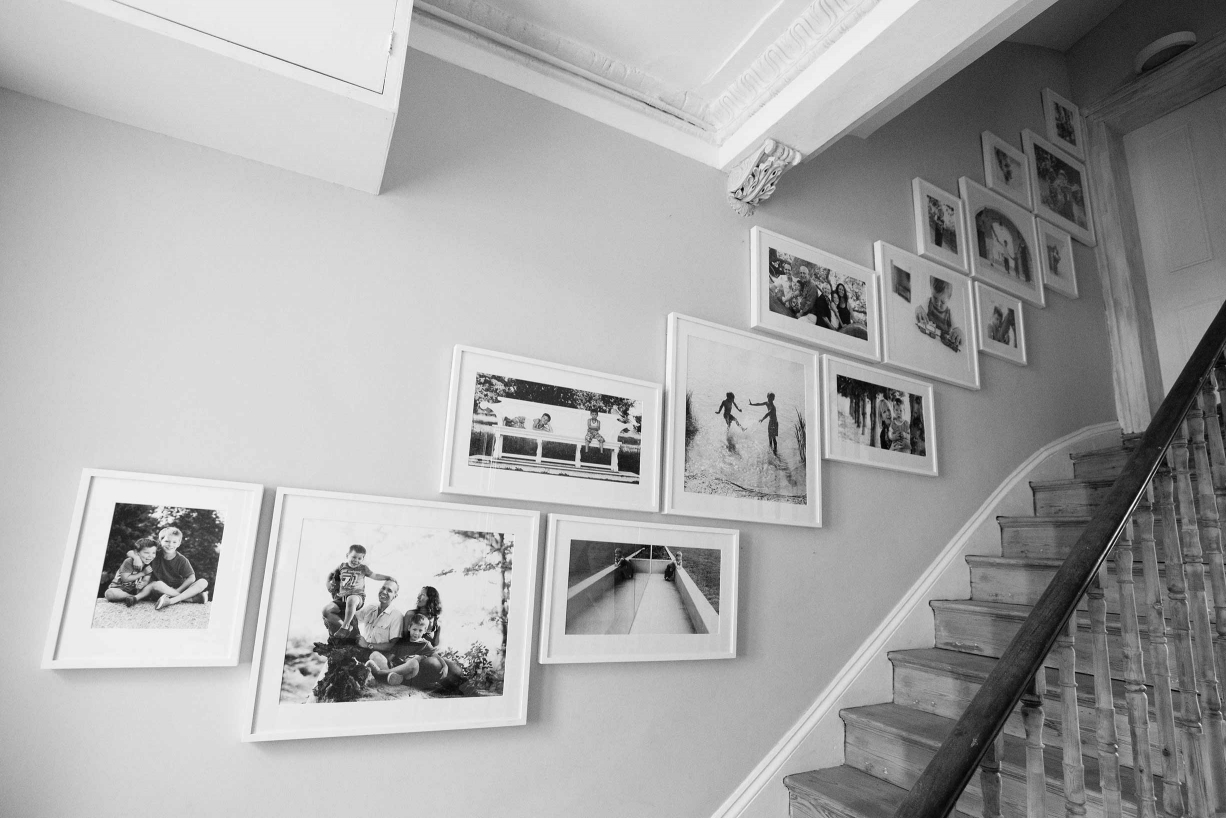 A stair gallery of family portraits taken by London portrait photographer Helen Bartlett.
