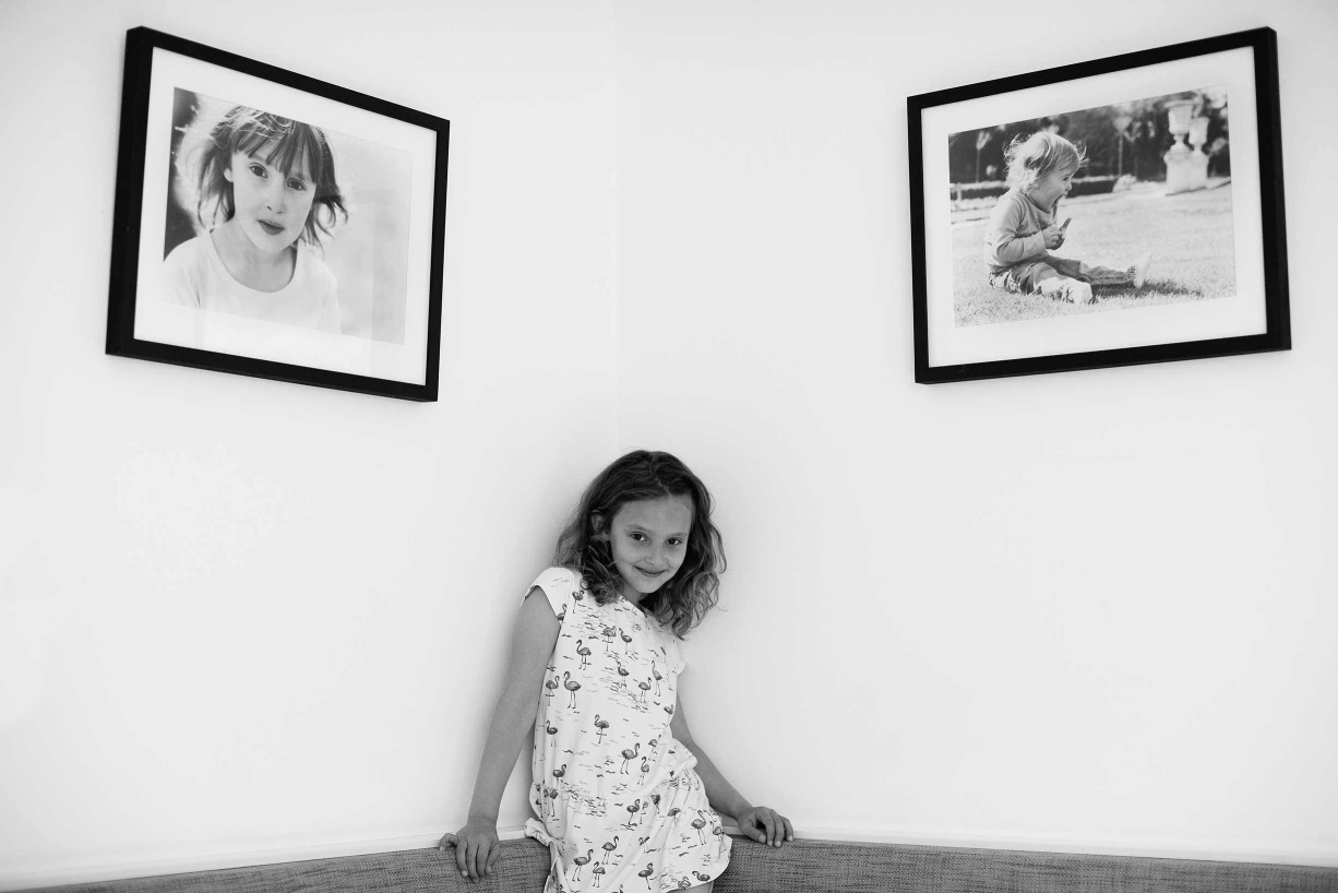 Two framed family portraits by London professional photographer Helen Bartlett.