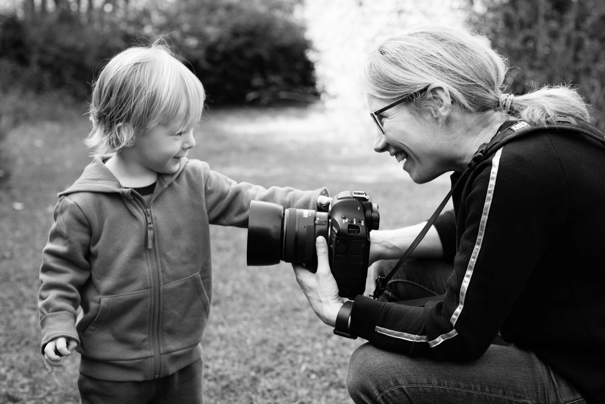 London professional family portrait photographer and Canon Ambassador Helen Bartlett with a young fan.