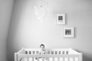 Butter wouldn't melt in this baby's minimalist portrait in their nursery.