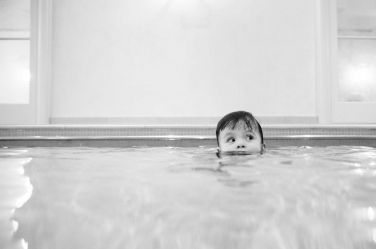 Just like the rest of us, this baby is trying to keep their head above water. London photographer Helen Bartlett takes photos like these during her black and white portrait shoots.