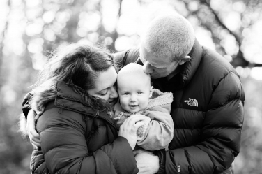 A winter portrait shoot with a baby can mean puffer jackets to stay warm.