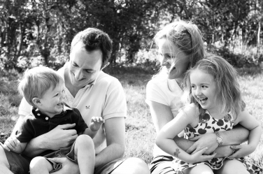 Natural giggles and sunshine make for a happy family portrait shoot.
