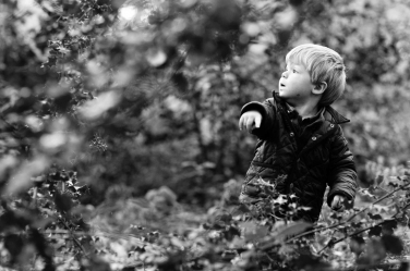 A small boy points during a winter portrait shoot by London photographer Helen Bartlett.
