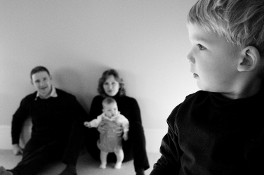 Family portraits can sometimes let one member be the hero, while the others have supporting roles.