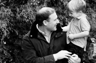 Father and son bond during their family portraits.