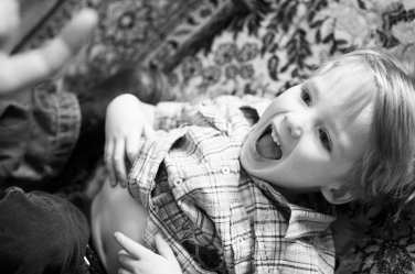 Tummy tickling is part of every family portrait session with children under five!