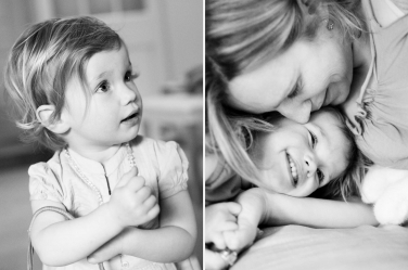 A playful daughter cuddles with her mother.