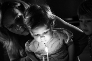 Birthday cake means candles and a photo of the moment that will live forever in this classic black and white photo.