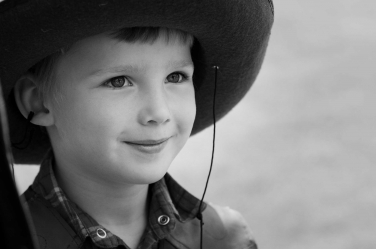 This cowboy is ready to take on the world in his family portrait session with London photographer Helen Bartlett.