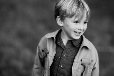 A boy's portrait, photographed from above to give a clean, uncluttered background in classic black and white.