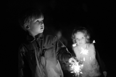 Sparklers light up small faces in this London winter family shoot.