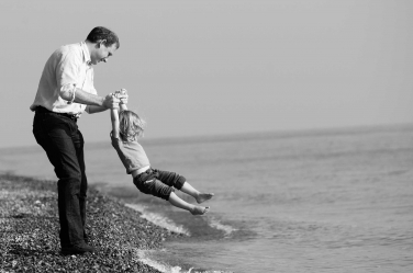 A father and daughter moment of catching the waves in this lifestyle shoot.