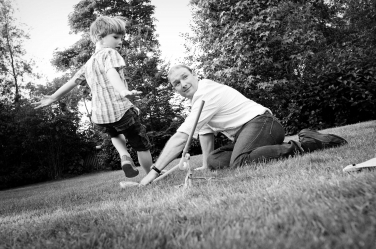 Father and son playing games during their lifestyle portraits.