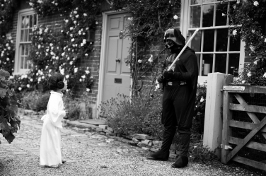 Who invited Darth Vader to the family home? A surprise visitor for this birthday party, photographed by portrait photographer Helen Bartlett.