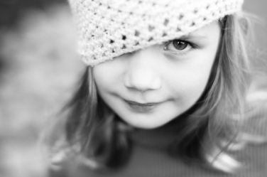 When your hat slips and you can't see! A girl's black and white portrait.