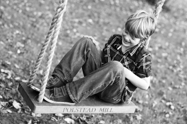 Giggles and a swing - childhood moments captured by photographer Helen Bartlett.