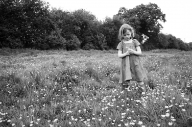Buttercups as far as the eye can see and one sweet girl - the recipe for a timeless black and white portrait.