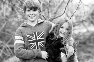 A black and white portrait of a brother and sister is part of a half-day lifestyle shoot with a family of four in London.