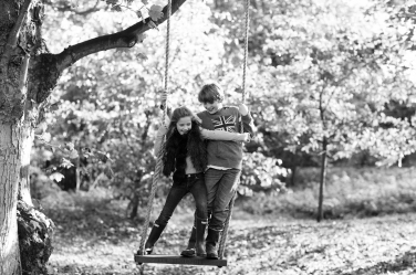 A brother and sister squabble over ownership of a swing.