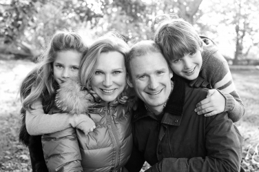 A classic portrait of a family of four taken by London photographer Helen Bartlett