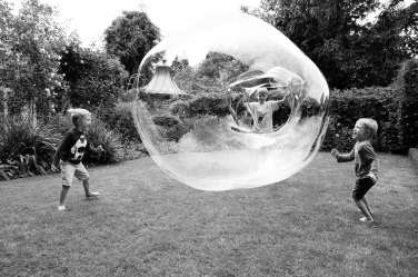 A giant bubble becomes the centre of this black and white family portrait shoot.