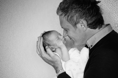 A father holds his newborn for its first portrait shoot in London.