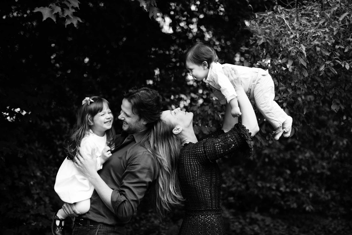 A natural portrait of a couple and their two children by family photographer Helen Bartlett, based in London.