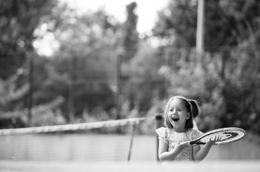 This girl's tennis win shows in her family portraits, taken while she was playing a game.