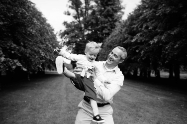 Dad swings his won around during a family photo session in London.