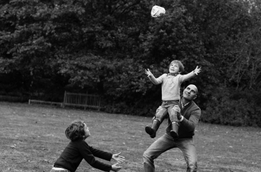 Family rugby stars in a father-sons lineout. The fun and games of this family are captured by London professional photographer Helen Bartlett.