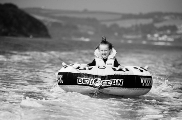 Bouncing along behind a boat is a great summer past-time, as this summer portrait shows.