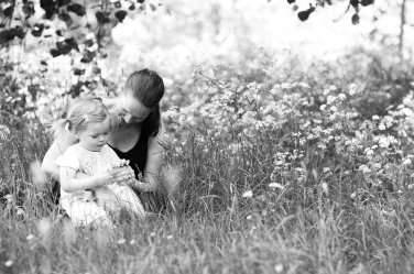 Mum and toddler in long grass during photo shoot in London for families.