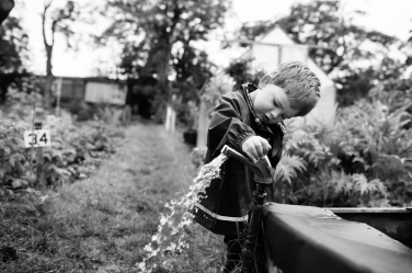 A small boy discovers how a tap works.