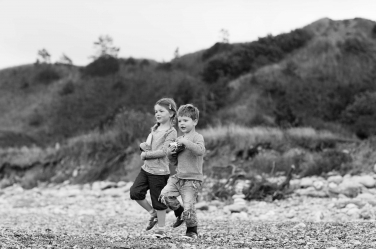 A black and white portrait of two children