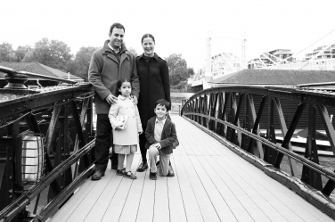 A family posed portrait on the bank of London's Thames.