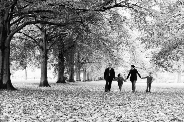 A family of four walks through a London park for a half-day portrait session.