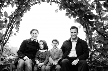A leafy framing for this black and white family portrait.