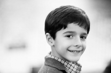 Black and white portrait of a boy.